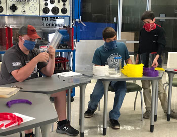 Volunteers working on face shields