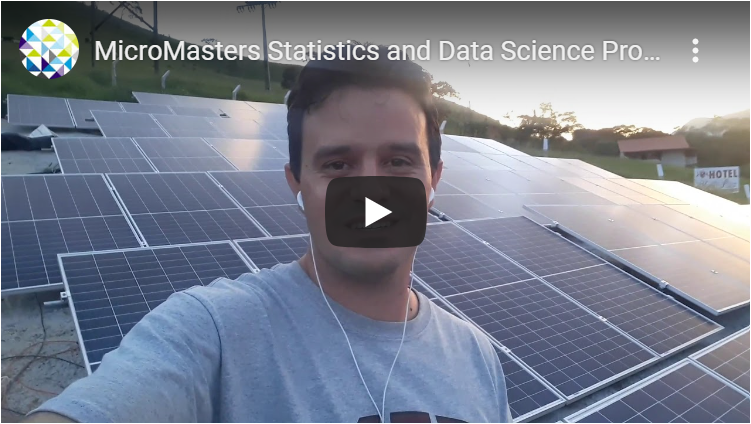 link to video with a person standing in front of solar panels