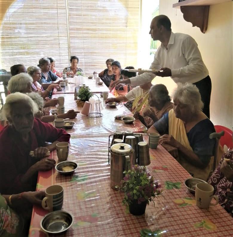 GOPIO Quatre Borne President Shamikapoor Sewoke serving food