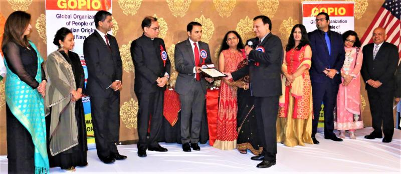 Shri Krishna Nidhi (SKN) Foundation  being honored for its service by GOPIO-CJ