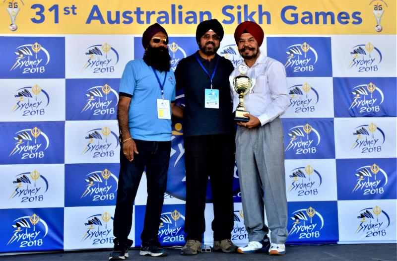 Satinder Singh Chawla receiving trophy at 31st Annual Sikh Games