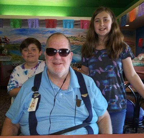 Former OCB client Carl Belnap, pictured with his grandchildren.