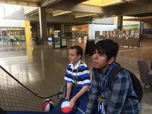 Photo of OCB SWEP student Daniel Bair playing an indoor basketball net game with another SWEP student.