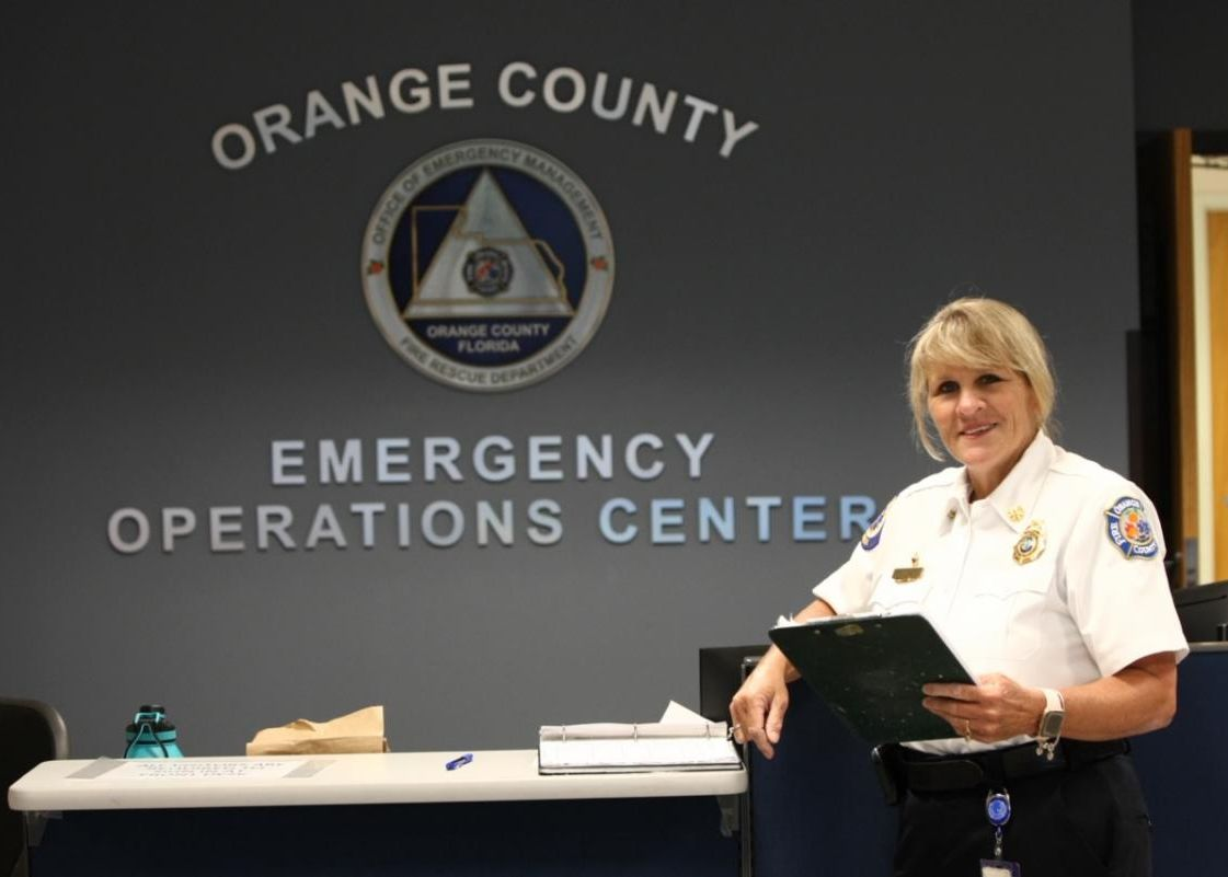 Chief Avery in front of a sign labeled Orange County Emergency Operations Center