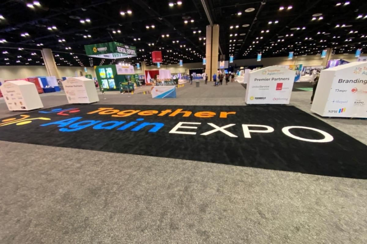Large convention space with a floormat that reads EXPO