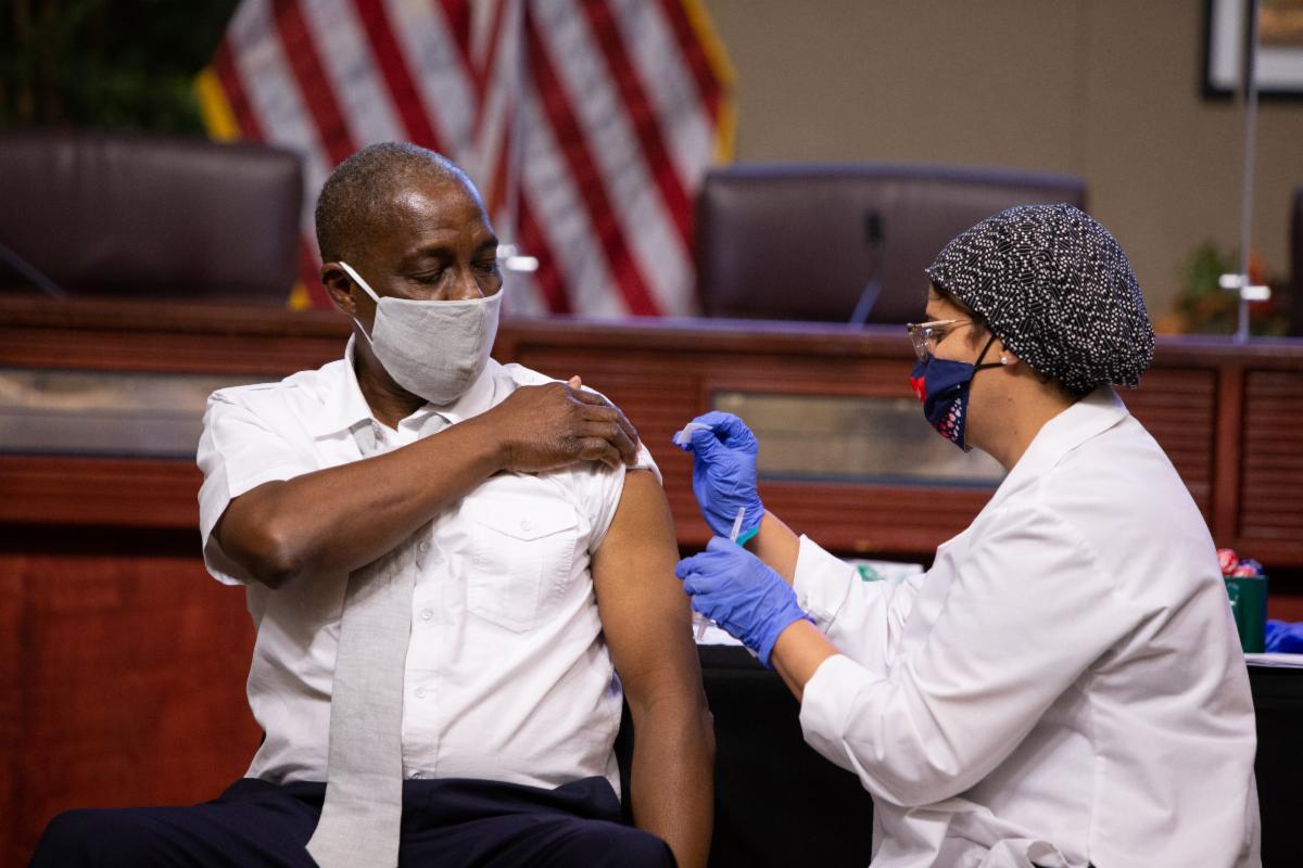 Homer Hartage receiving a vaccination