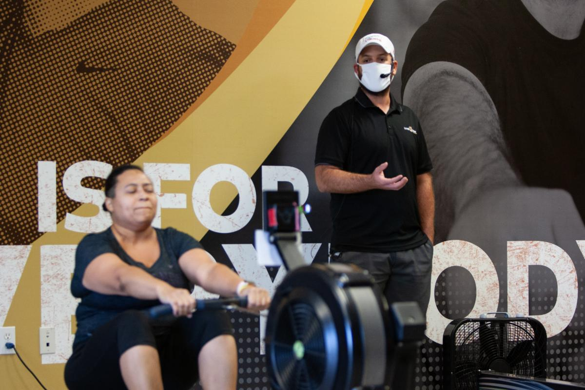 People in a gym wearing masks