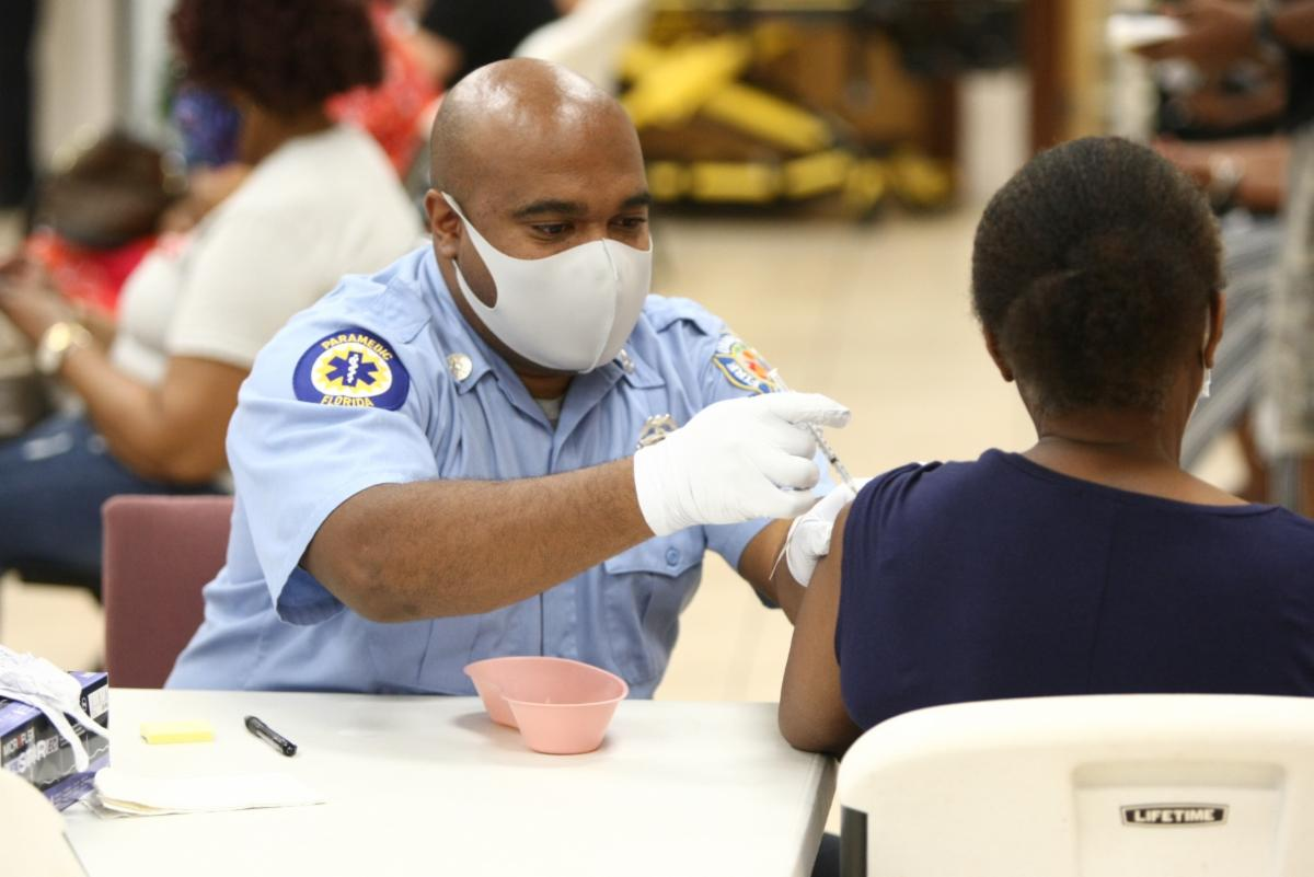 Healthcare professional administering a vaccine shot