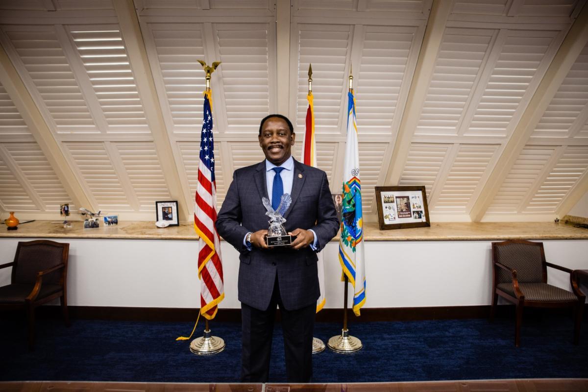 Mayor Demings holding an award