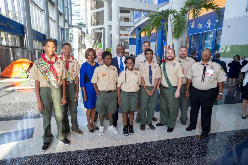 A group of ten scouts and leaders are standing with Mayor Demings and Representative Demings.