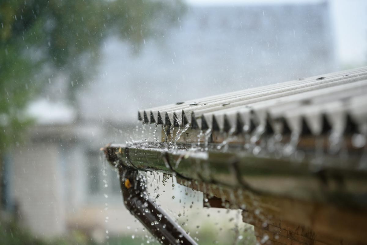 Rainwater dripping from a roof