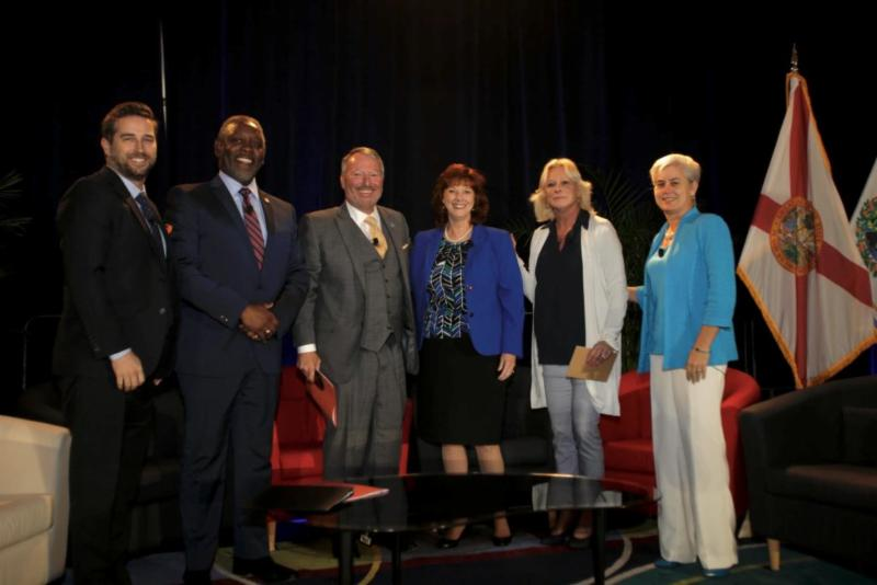 Mayor Demings, Mayor Dyer, Tim Giuliani from the Orlando Economic Partnership, and the chairs from Seminole, Lake, and Osceola County stand for a photo at the 2019 Orange County Regional Economic Summit.