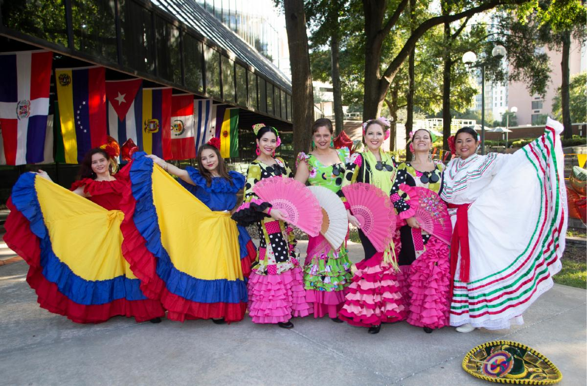 Performers dressed in colorful costumes representing Hispanic culture