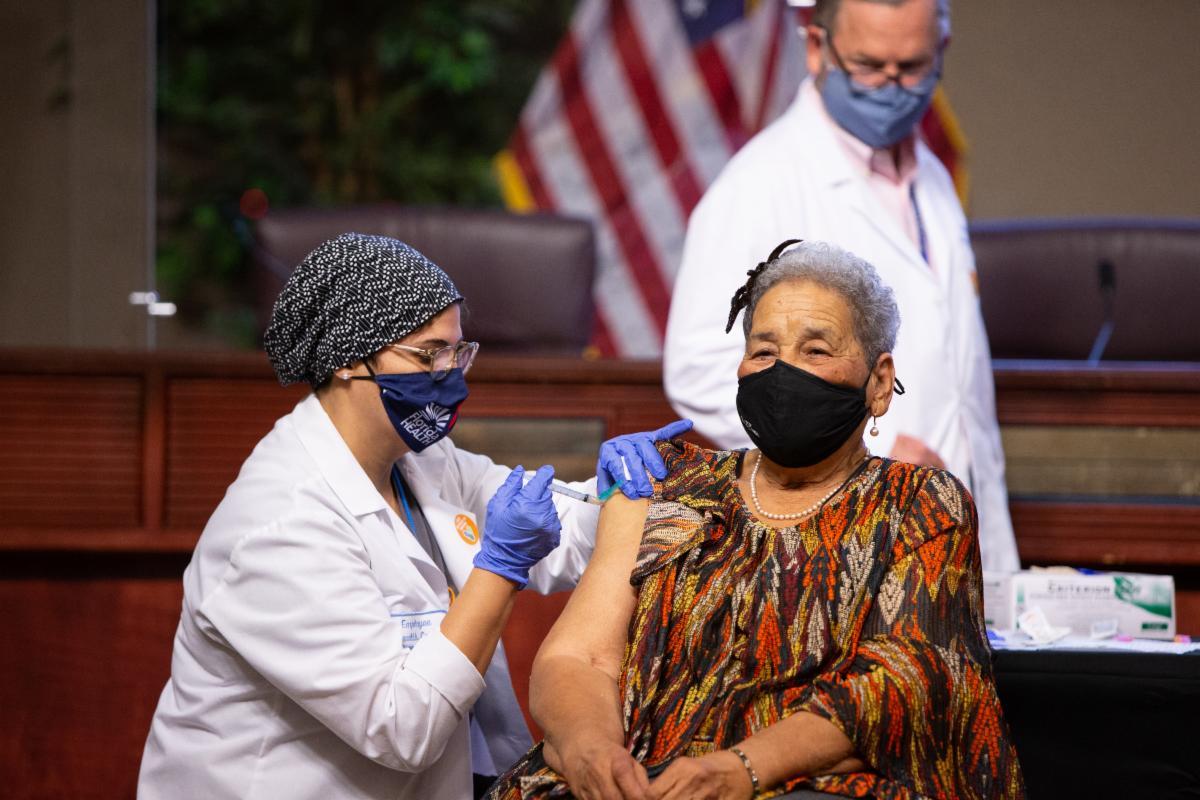 Mabel Butler receiving a vaccine