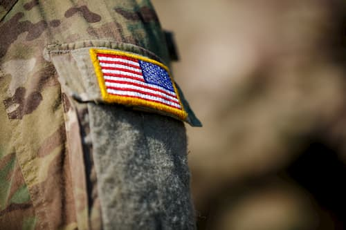 American flag patch on a soldiers arm