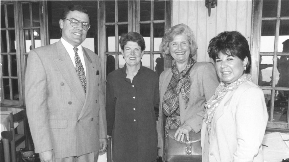 A black and white photo of four people
