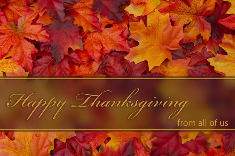 Happy Thanksgiving Greeting Fall Leaves Background and text Happy Thanksgiving from all of us