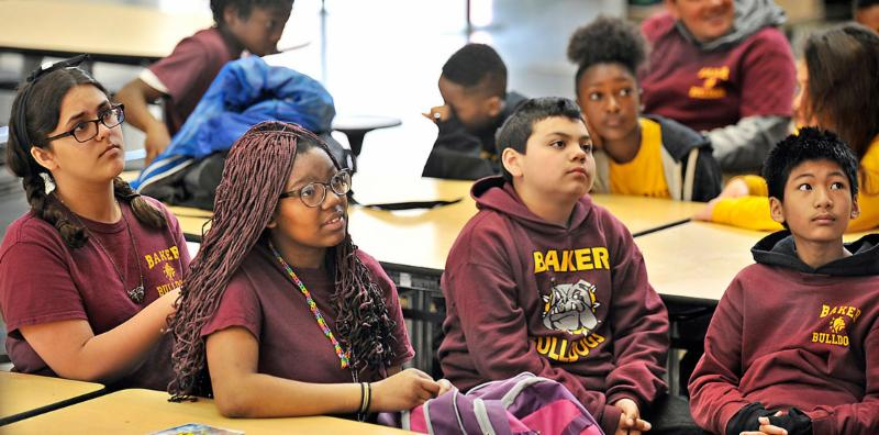 uthor Jason Reynolds tells Baker Middle School students what motivated him to start writing