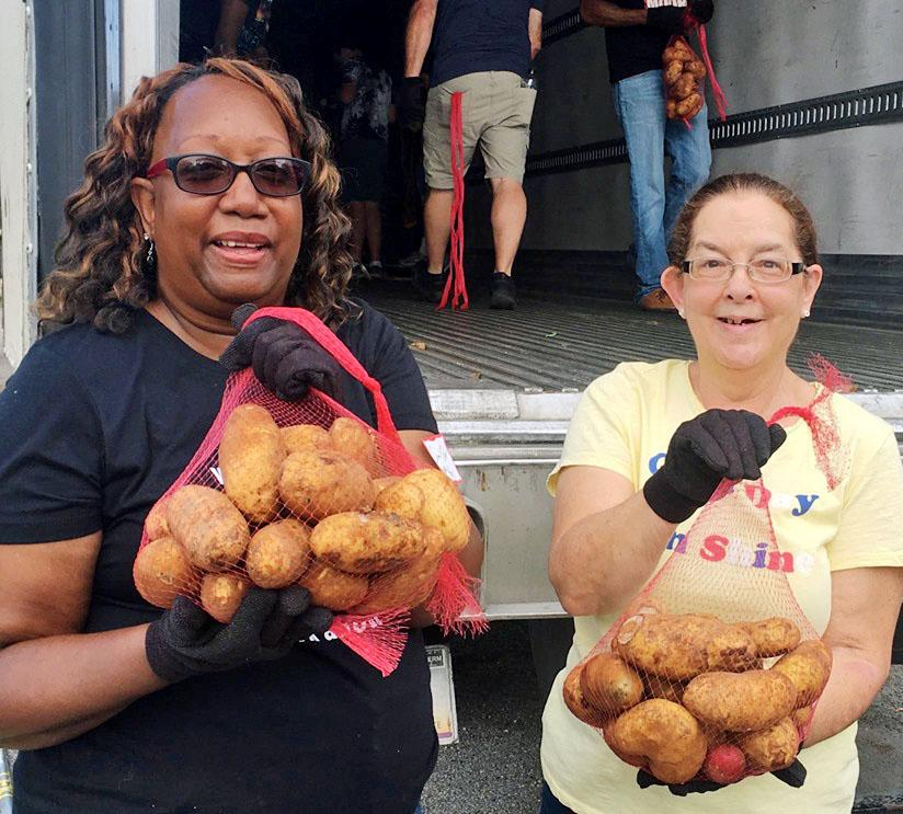 Volunteers help share food with their community at a crop drop.