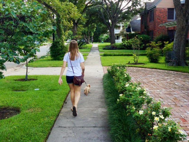 female pedestrian walking on a sidewalk