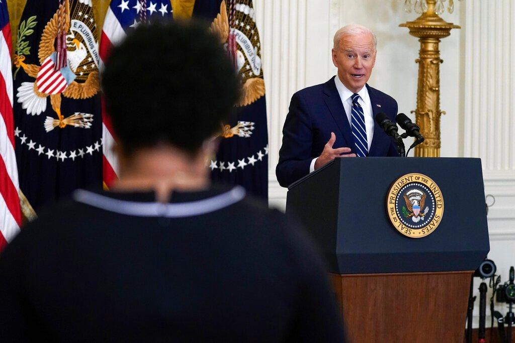 President Biden speaking at podium