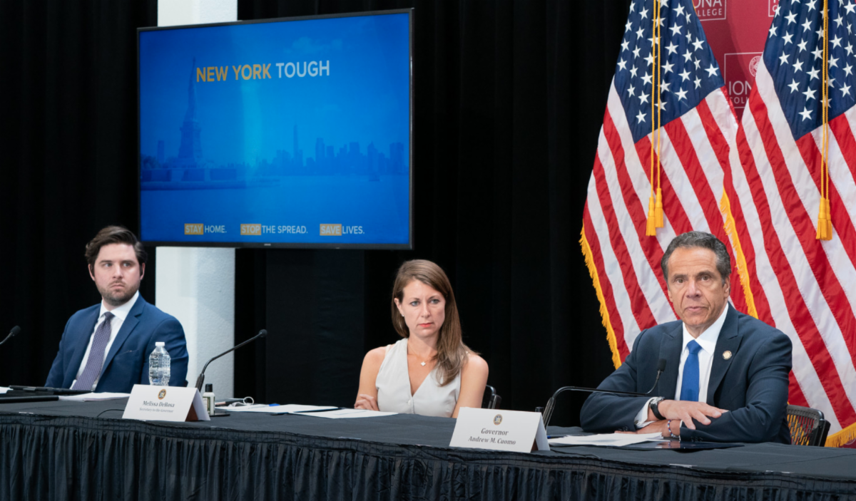 governor cuomo and a man and a woman at a coronavirus briefing