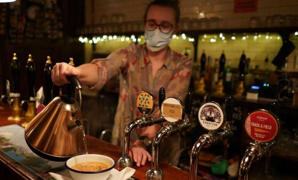 Woman pouring tea at a bar