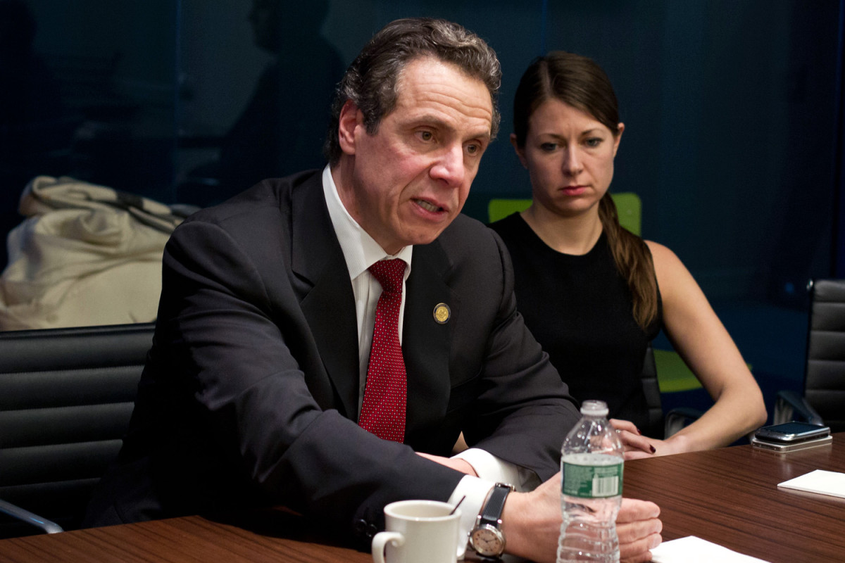 Governor Andrew Cuomo at a table speaking