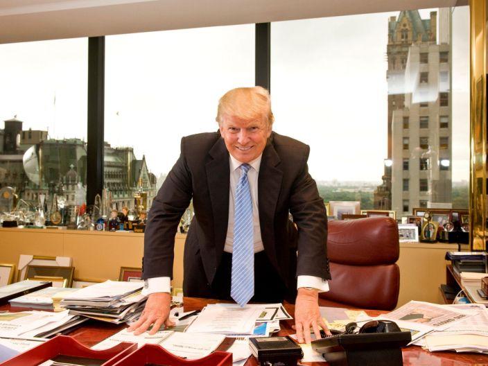 Donald Trump standing behind desk