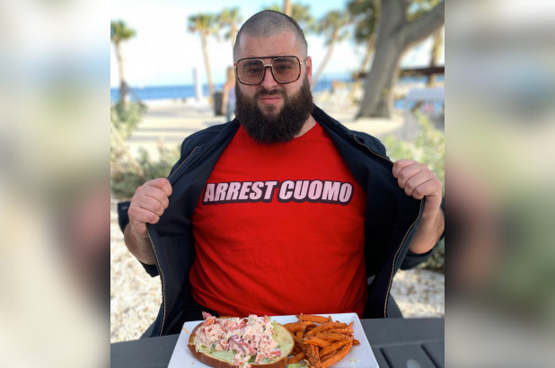 Guy in Arrest Cuomo t-shirt