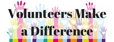 colorful hands raised with text Volunteers Make a Difference