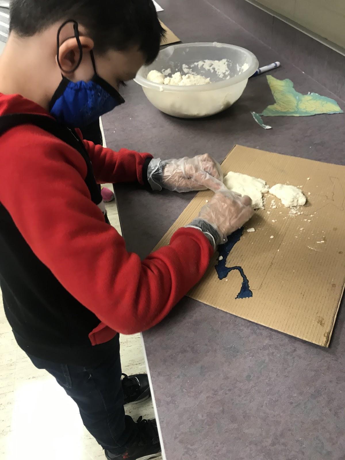 student making a salt map