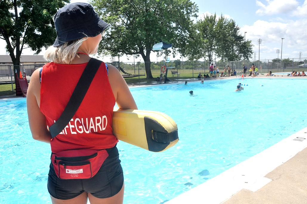 Lifeguard overlooking Lion Dunc Schooley Pool in Merritton