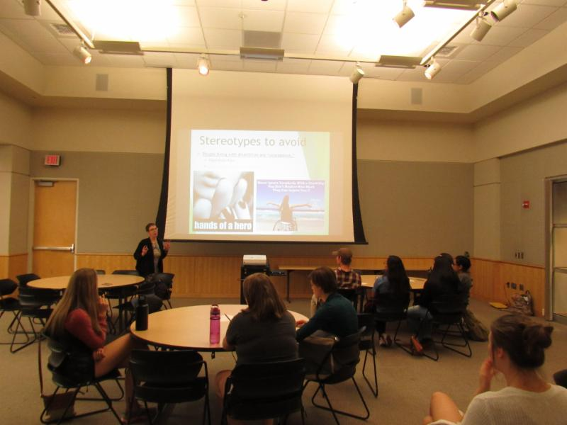 Jen Magelky-Seiler presenting to eight students on disability etiquette