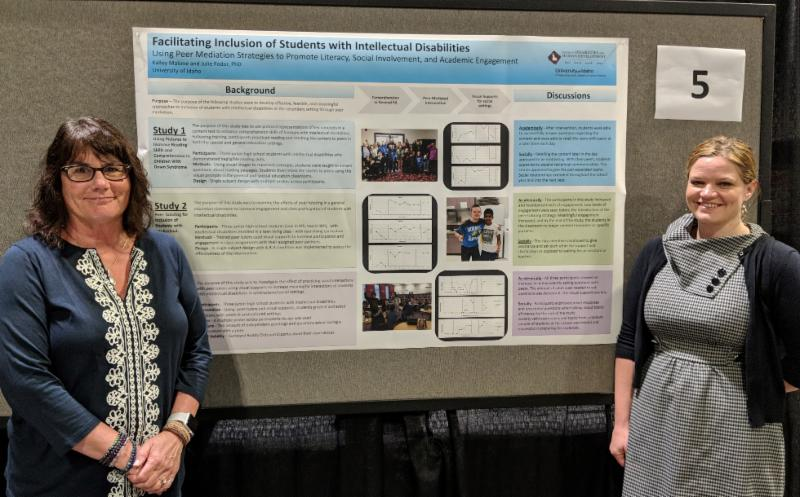 Julie Fodor and Kalley Malone pose in front of poster that was presented at CEC.