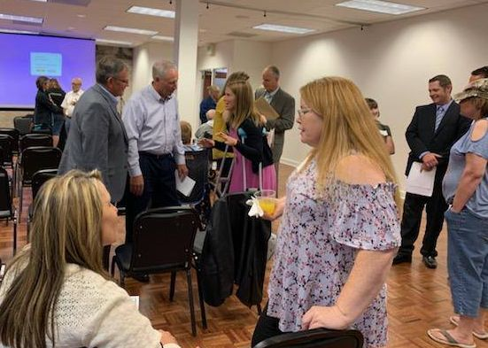Community members attending Blessings of Liberty in Idaho Falls network with each other and legislators