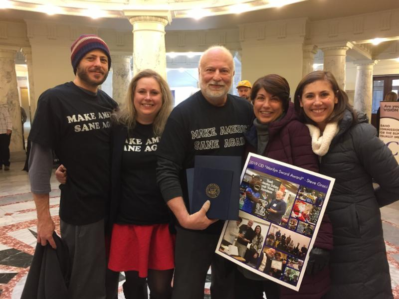 Steve pictured with family members at the capitol.
