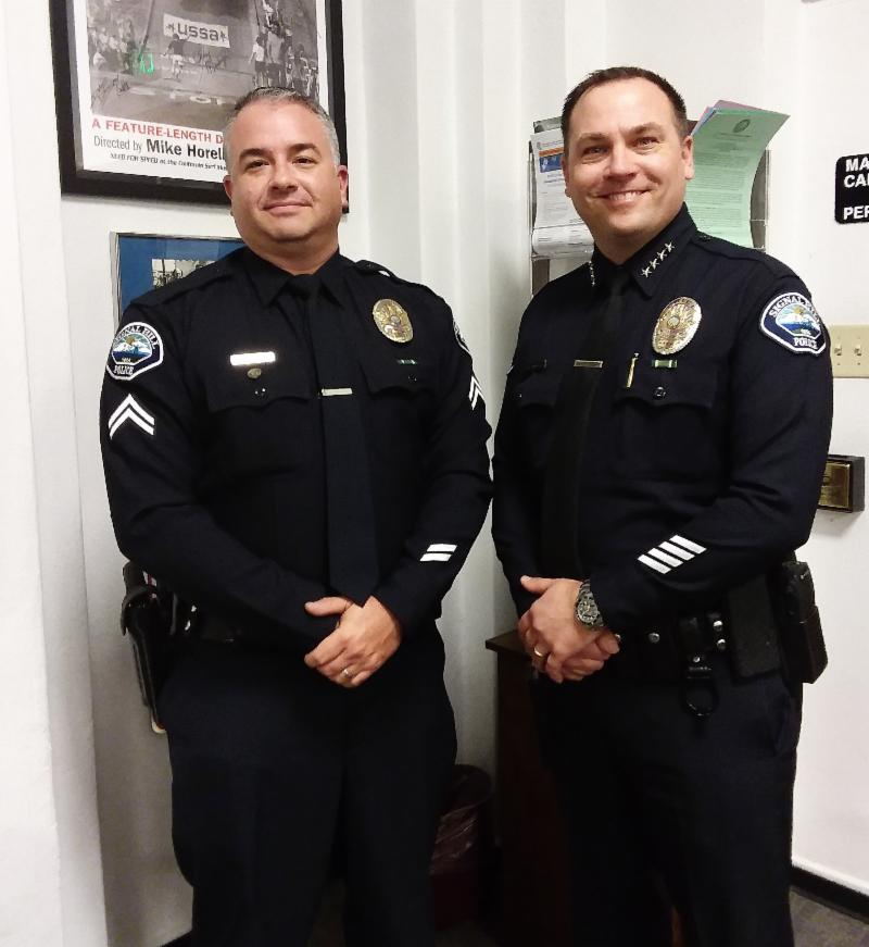 From left to right, Senior Officer Don Moreau, Signal Hill Police Chief Chris Nunley