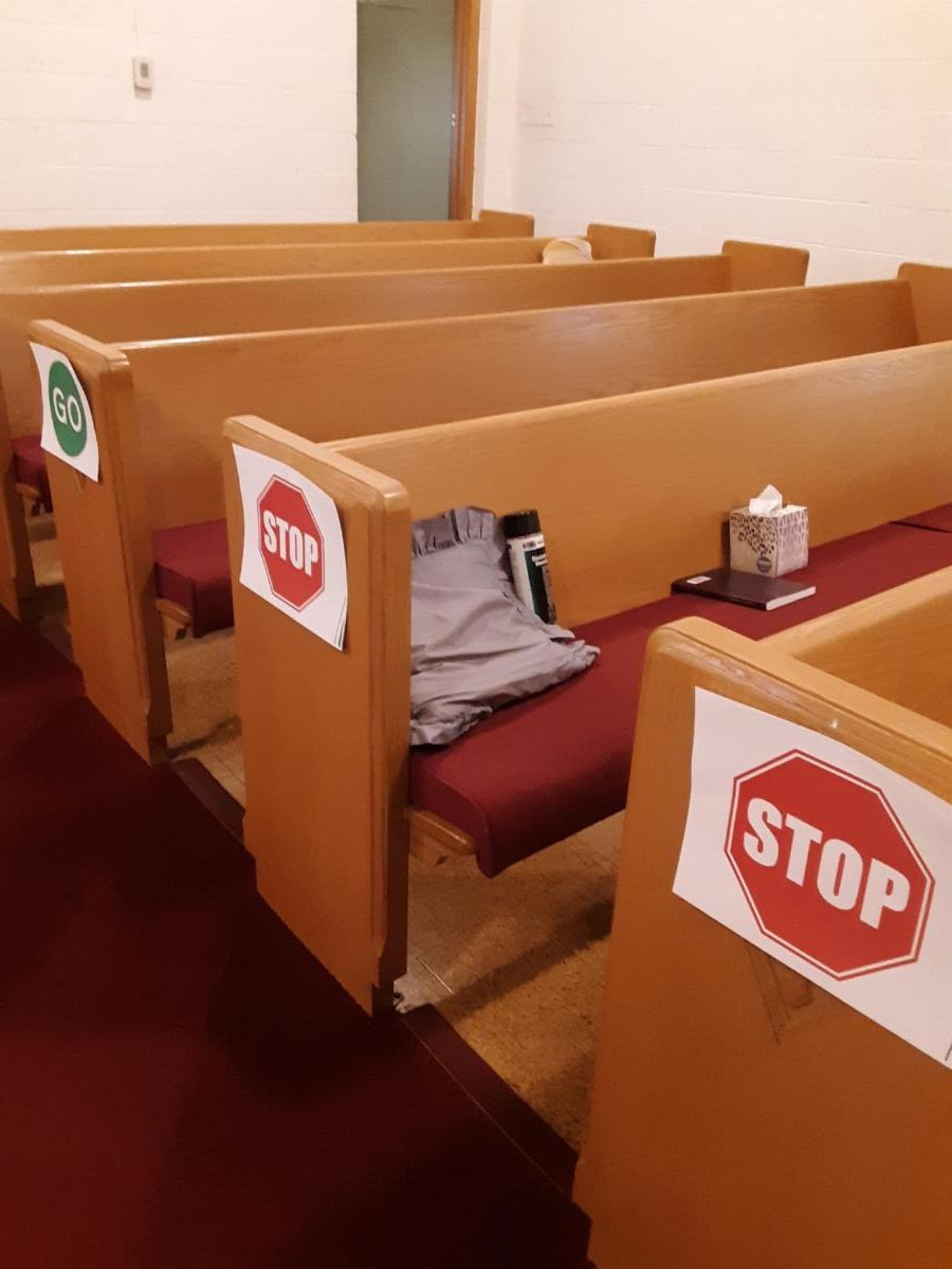 Permitted and not permitted seating signs on pews
