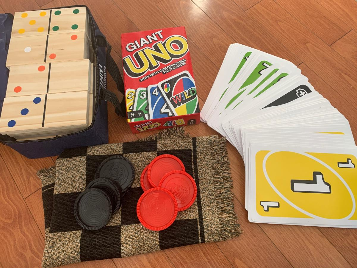 Dominoes, Checkers and Uno games displayed on a table
