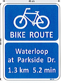 Bike route signage indicating trail route and km distance