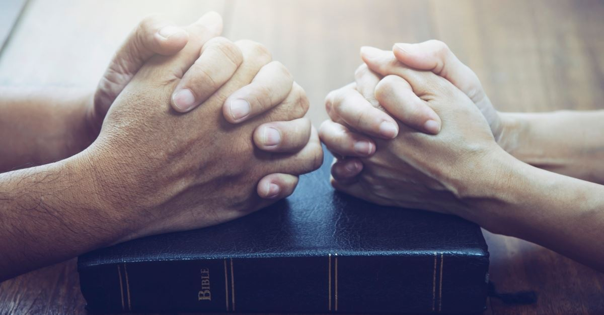 68697-couple-praying-bible-gettyimages-freedom007.1200w.tn.jpg