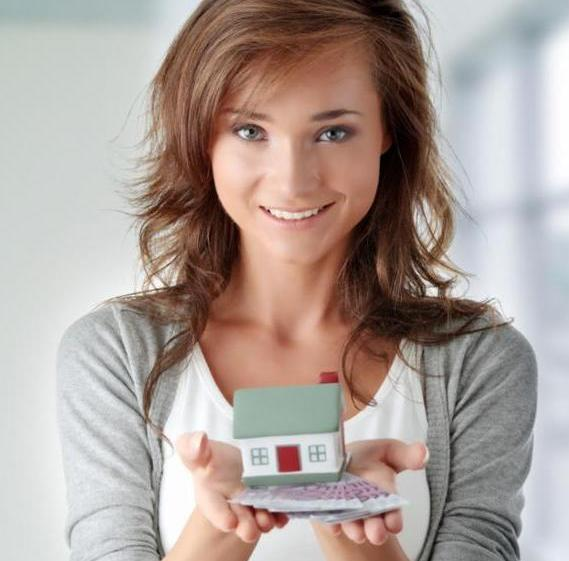 woman_holding_little_house.jpg