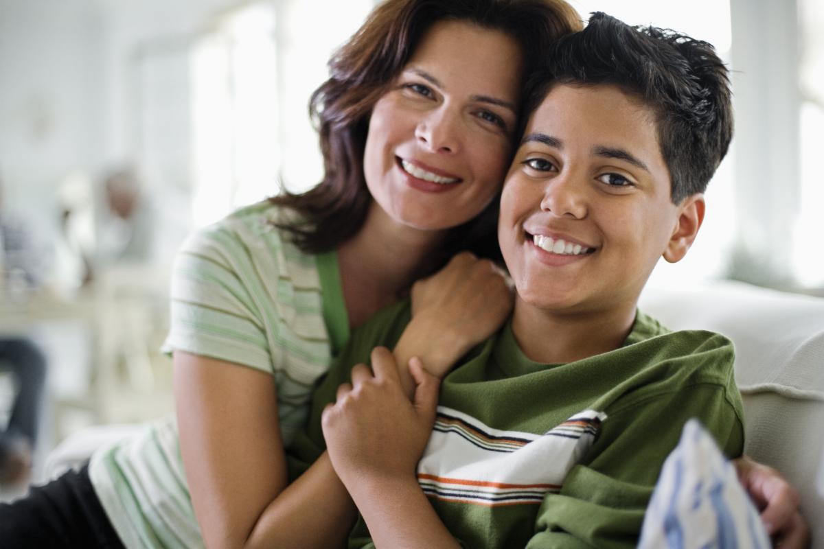 Mom hugging teen son