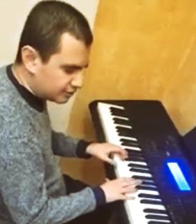 Man at digital keyboard