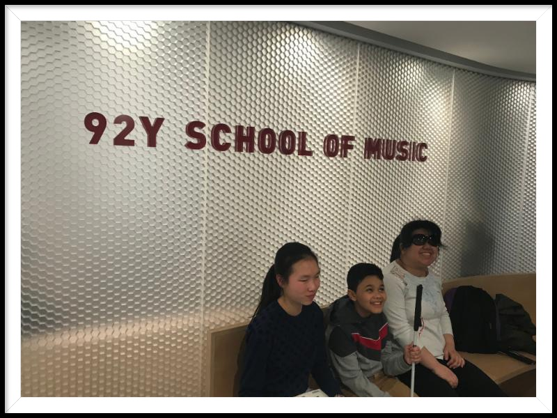 three students sitting in front of the 92 Y School of Music sign