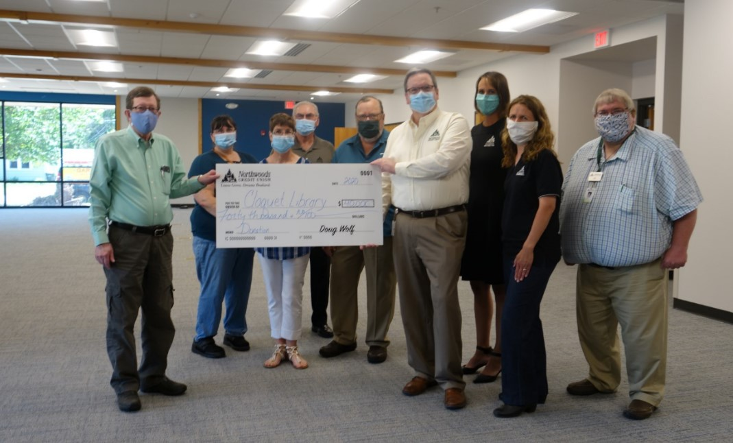 Library Foundation Board members with NCU Board Members holding large check for $40,000
