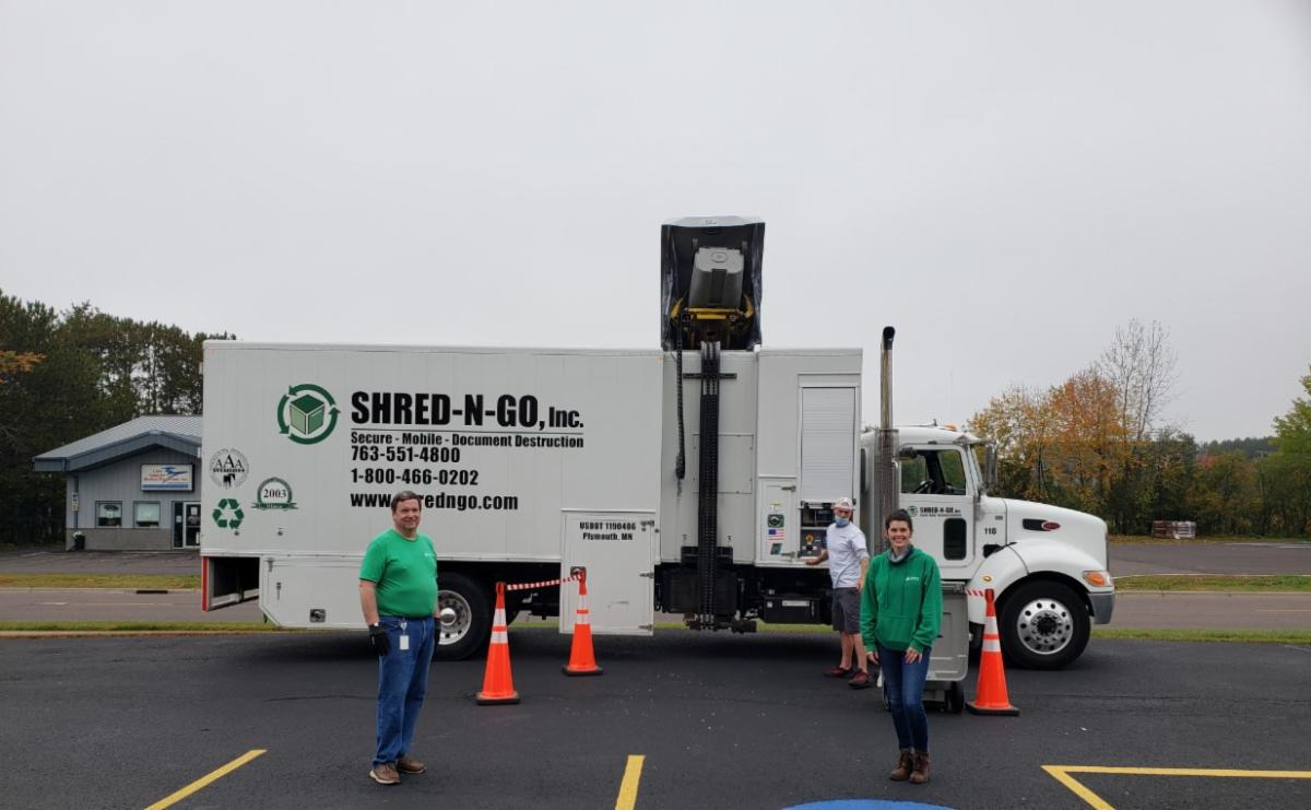 Shred N Go truck parked in front of 902 Stanley Ave office in Cloquet. Doug and Kate pictured.