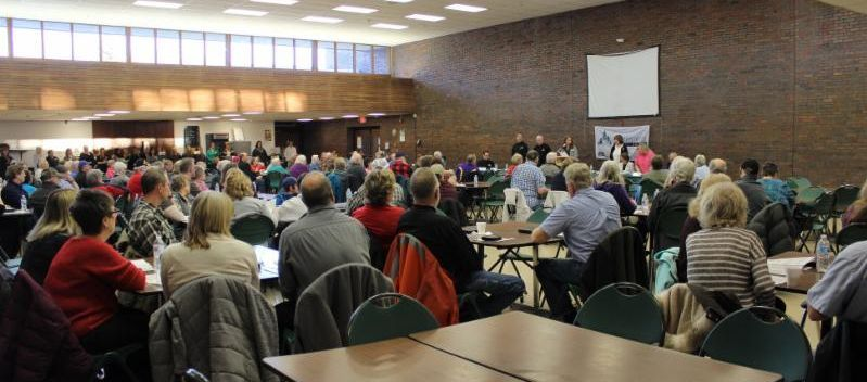 Photo of people attending the 2019 Northwoods Credit Union Annual Meeting at the Cloquet Senior High Cafeteria.