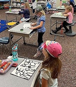 Students wearing favorite hats